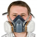 Mask fitted with combination of; gas and vapour cartridges and dust filters that are held in place with the filter retainers